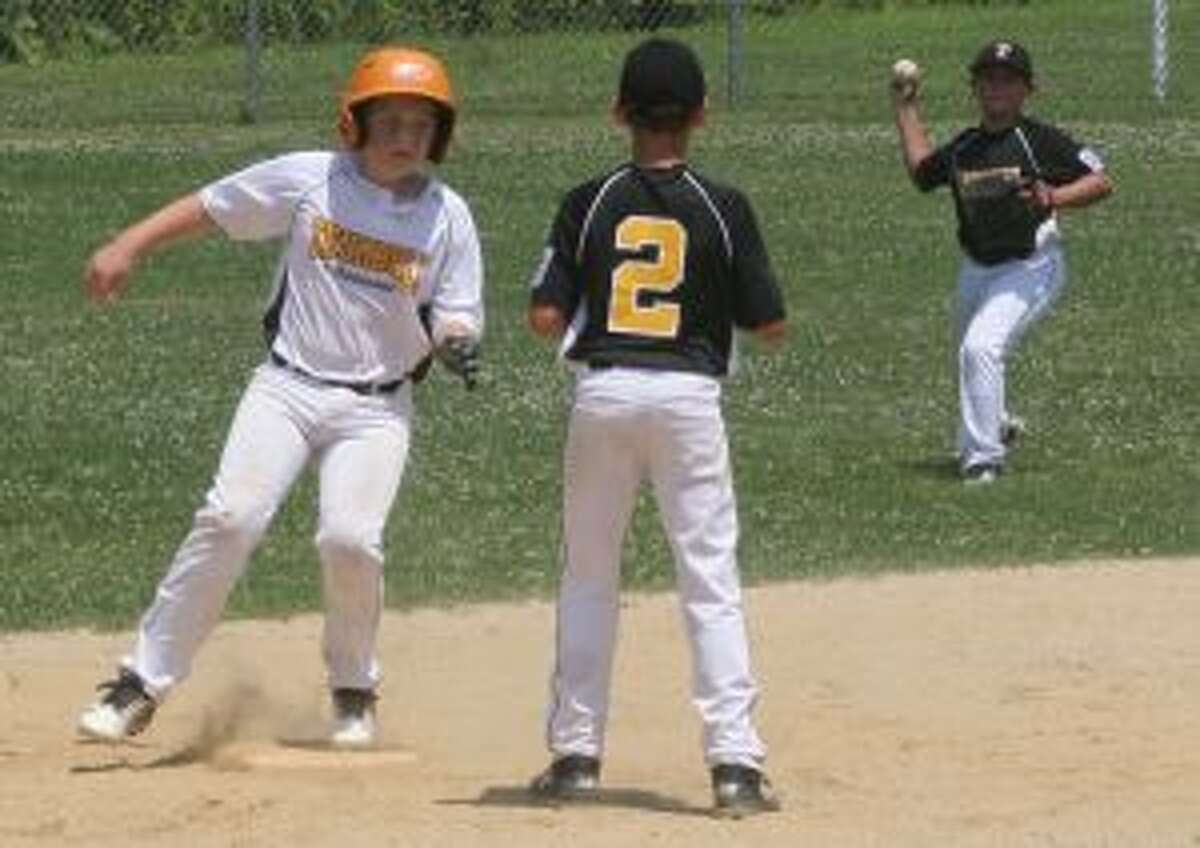 Trumbull National's James Callaghan looks to third base after he hit a double in the second inning.