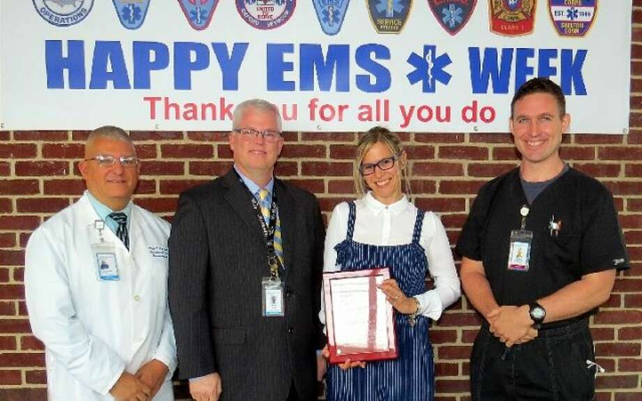 Trumbull EMS Paramedic Leigh Goodman, second from right, was recently named Bridheport Hospital EMS Provider of the Year. She was presented the award by Bridgeport Hospital staff members Paul Possenti, Wes Young, and Doug Latham. — Submitted photo