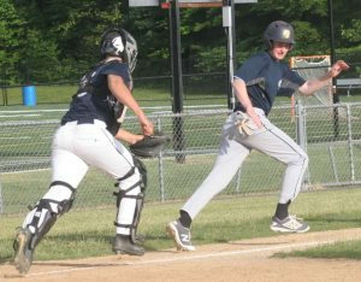 Andrew Weinbrum is caught in a run down by Trumbull catcher Rob Goldsmith.