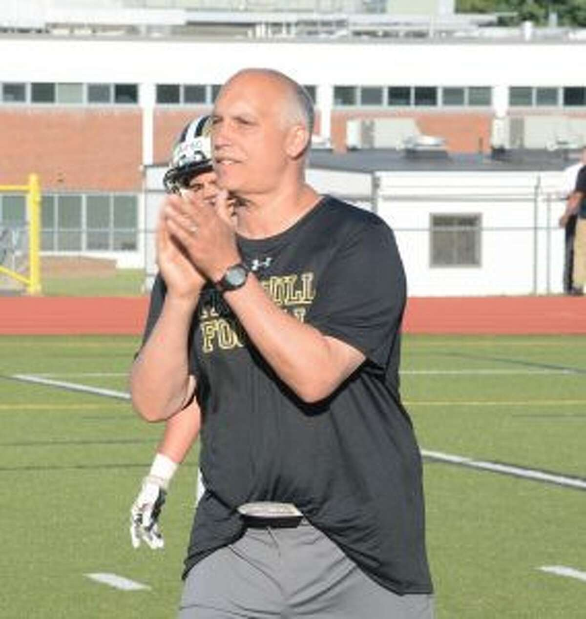 Marce Petroccio encourages his players at the annual Black and White spring game. - Andy Hutchison photos