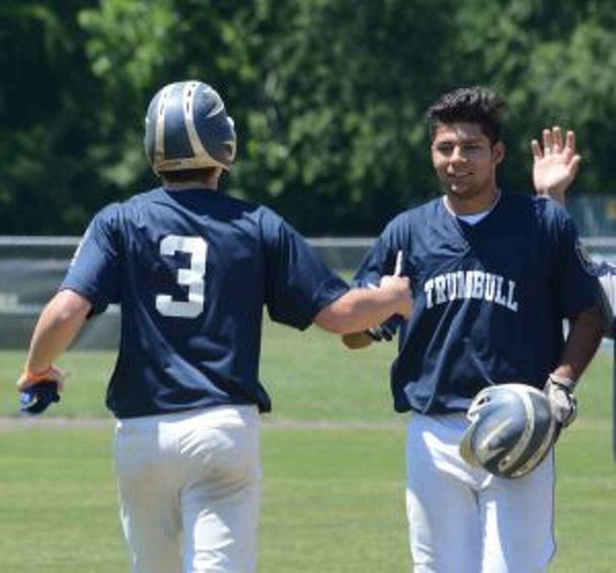 Jake Teixeira is congratulated by Danny Ruchalski (3) after driving in the winning run.
