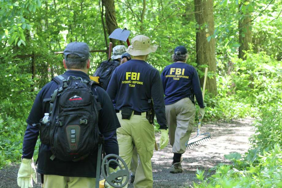 Members of an FBI Evidence Response Team searched Waveny Park near the bridge that carries Lapham Road over the Merritt Parkway on June 3 as part of the Jennifer Dulos case. Photo: John Kovach / Hearst Connecticut Media / Connecticut Post