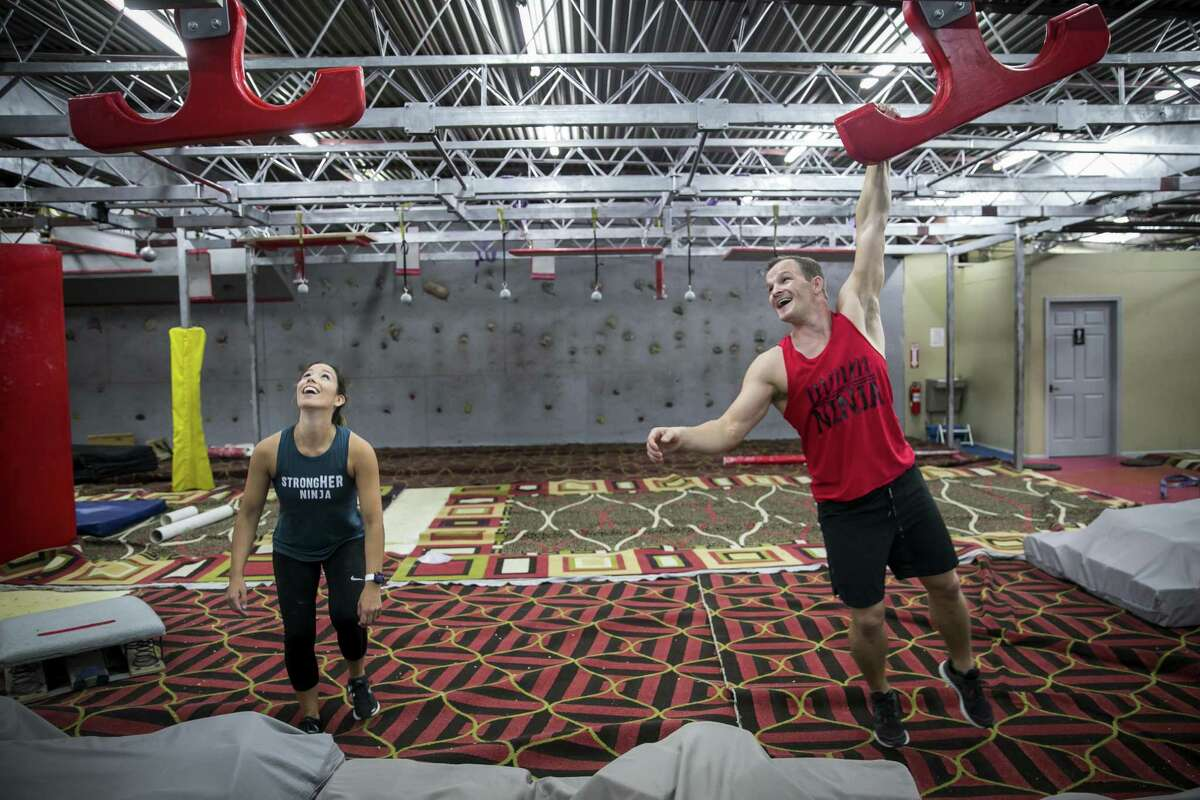 Lauren and Mike Murray play on 'American Ninja Warrior' wingtips at Iron Sports Gym.