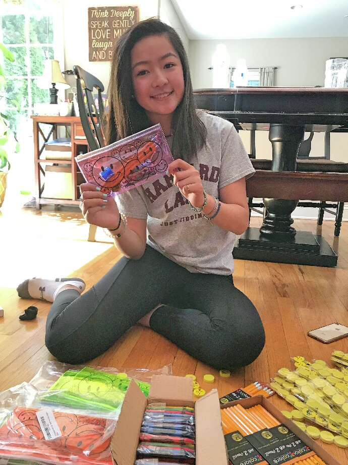 Trumbull High freshman Emily Kong hopes to send hundreds of school supply pouches to poverty-stricken children in Cambodia.
