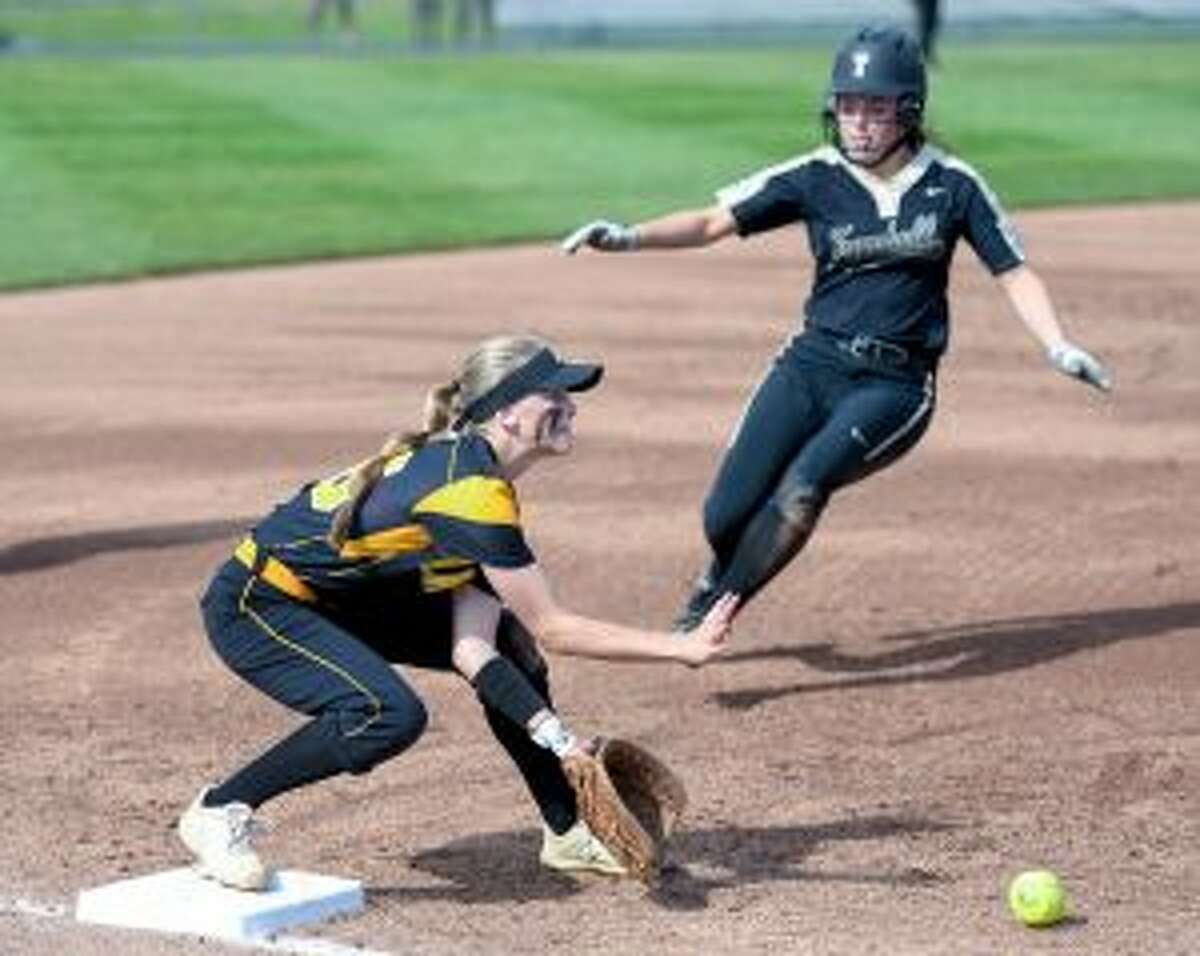 Courtney Fairfield, who hit a grand slam home run for the Eagles, is out at third on a force play in the second inning. - David G. Whitham photo