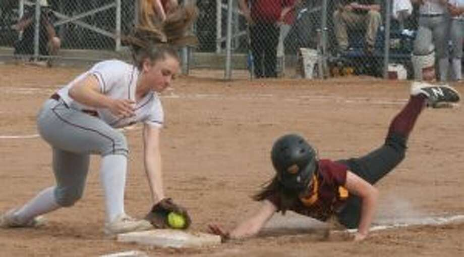 Cami Heintz takes a throw from Kayla Giacobbe and tags the bag to double off Mackenzie Dowd. — Bill Bloxsom photos