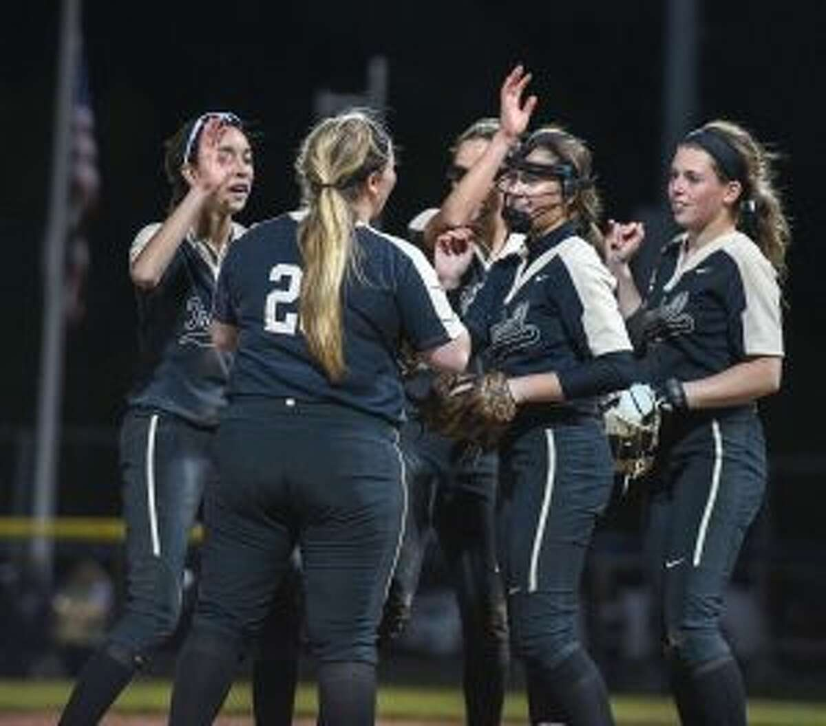 Trumbull's infield surrounds Emily Gell after her strikeout closed the door on Cheshire. - David G. Whitham photos