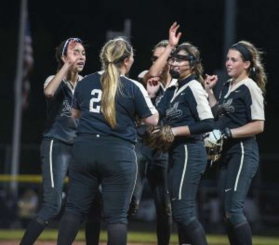 Trumbull's infield surrounds Emily Gell after her strikeout closed the door on Cheshire. — David G. Whitham photos