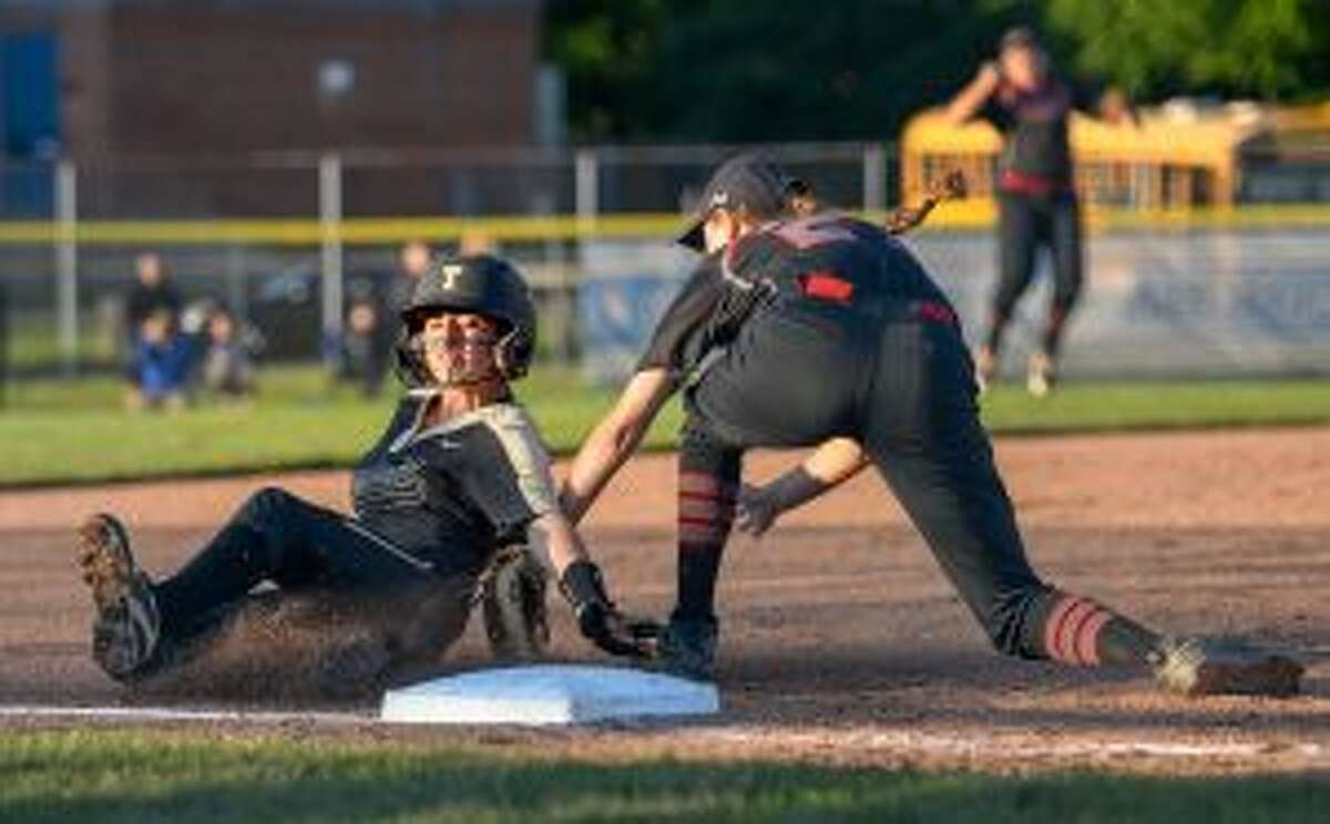 Maggie Coffin slides safely into third ahead of a tag and later scored a run in the first inning.