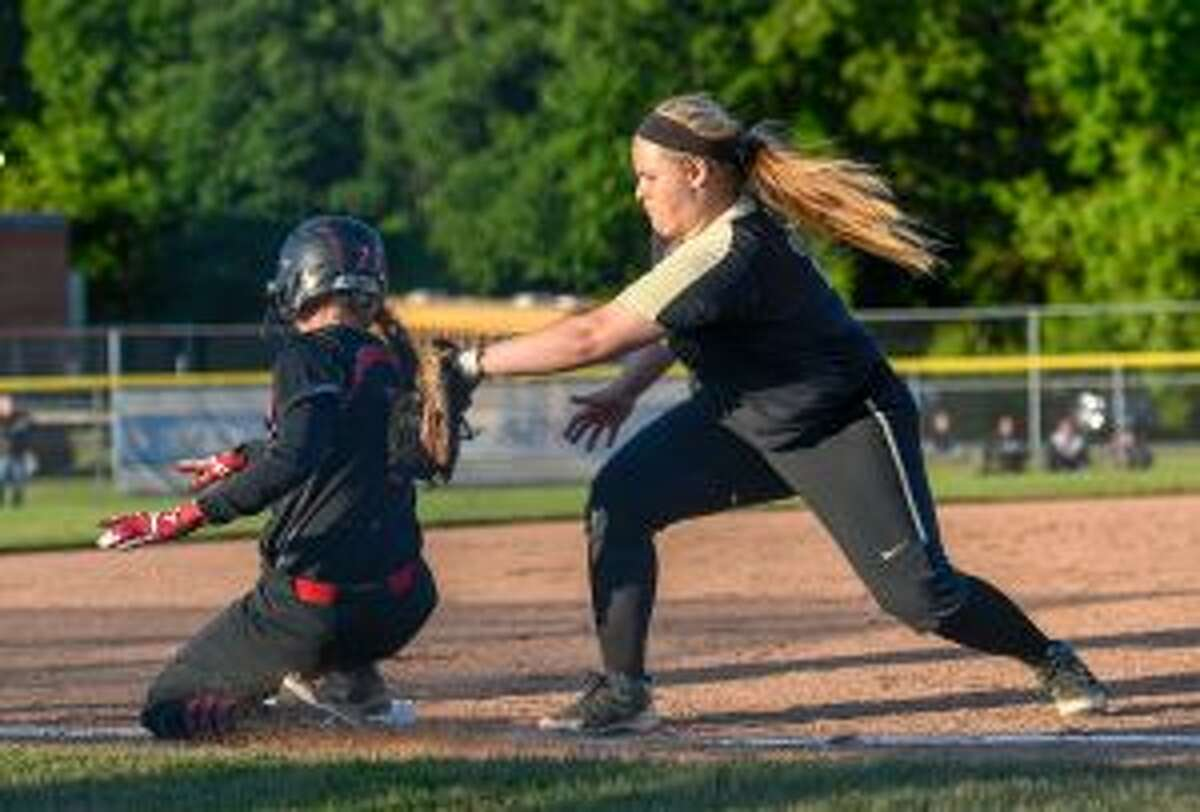 Delihla Destefano takes a throw from catcher Cassi Barbato and looks to catch Cheshire's Sara Mulligan off the bag at third.