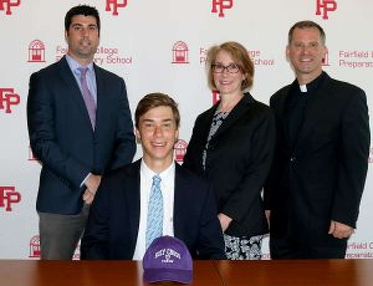 Nick Stachurski is pictured with Athletic Director Tom Curran, mother Susan Sieber and Pres. Rev. Tom Simisky, S.J.