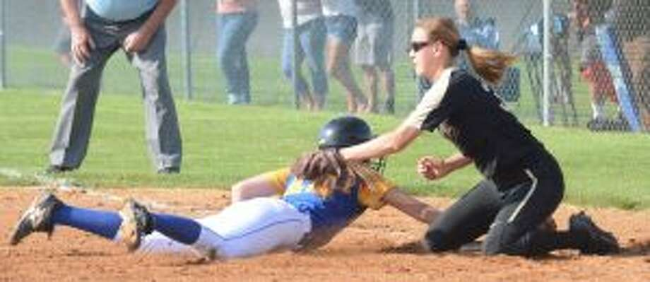 Trumbull 's Meghan Geraghty looks to put the tag on a sliding Shannon Cheh. — Andy Hutchison photos