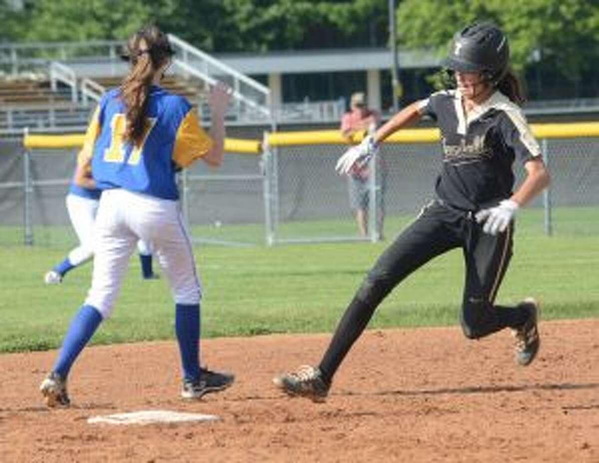 Julia Huzi rounds second base.