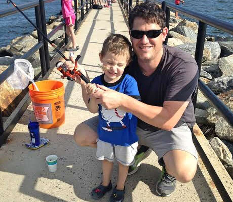 Michael and Ryan Joyce fish off the pier in Fairfield for snapper blues. Ryan's Rebels, created by Michael and his wife, Caroline, after Ryan died a few weeks before his fourth birthday, will host a fishing derby Saturday, June 2, at Twin Brooks Park. — Contributed photo