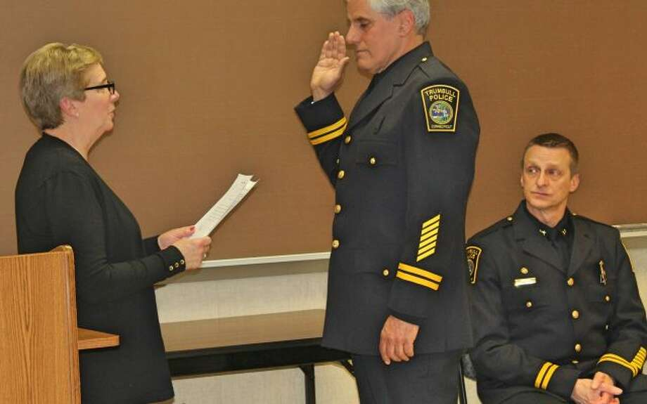 Deputy Chief Leonard Scinto is sworn into his new role by First Selectman Vicki Tesoro May 17. Assistant Chief Glenn Byrnes, right, also received his promotion that afternoon.