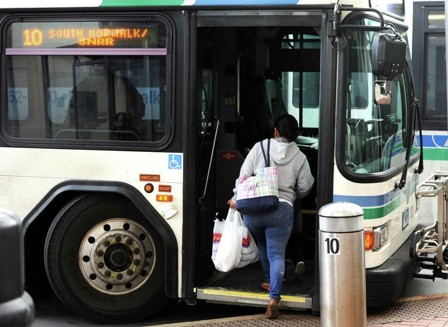 A rider boards a bus in Norwalk. Photo: Cathy Zuraw / Hearst Connecticut Media / Norwalk Hour