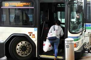 A rider boards a bus in Norwalk.