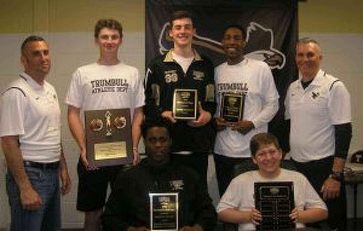 The Trumbull High boys basketball team honored some of its best players. Pictured (front row) are Quentar Taylor and Kyle Brennan; (second row) assistant varsity coach Matt Landin, Chris Brown, J.P. Fromageot and head coach Buddy Bray.