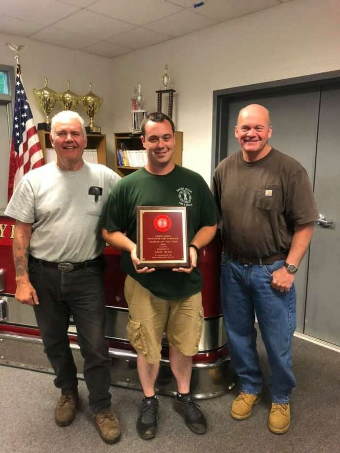 Second Assistant Chief Andy Ryan, center, was named Sandy Hook Volunteer Fire & Rescue's 2019 Firefighter of the Year. Photo: Sandy Hook Volunteer Fire & Rescue / Facebook