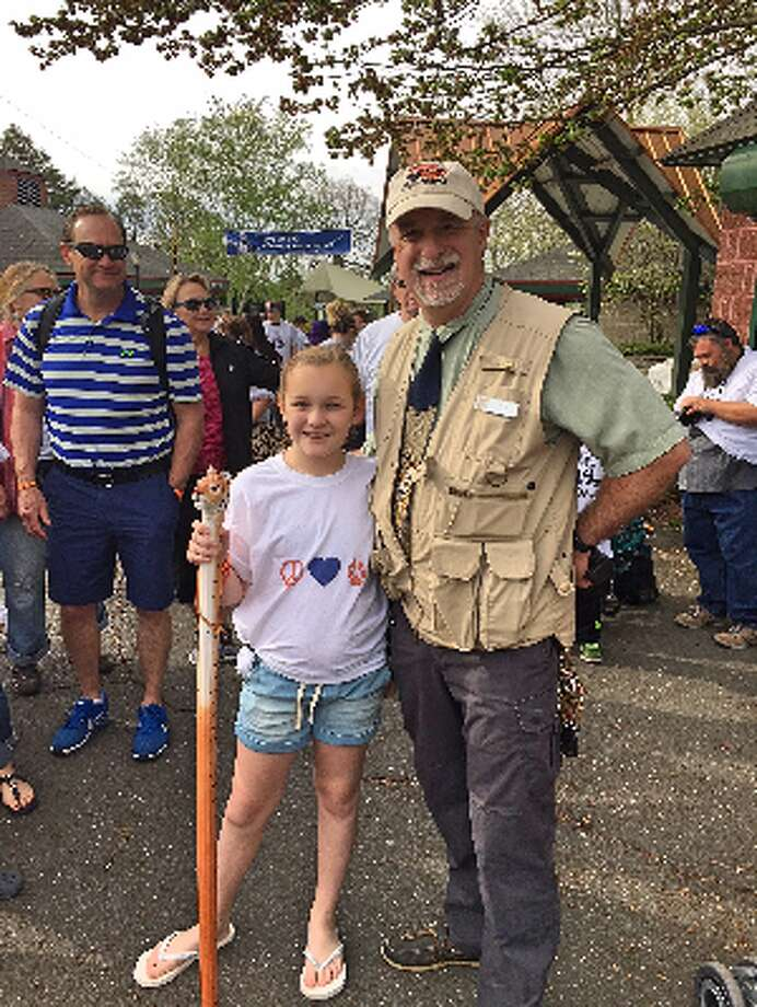 Trumbull student Samantha Petiprin, 10, and Zoo Director Gregg Dancho at Saturday's Tiger Trot.
