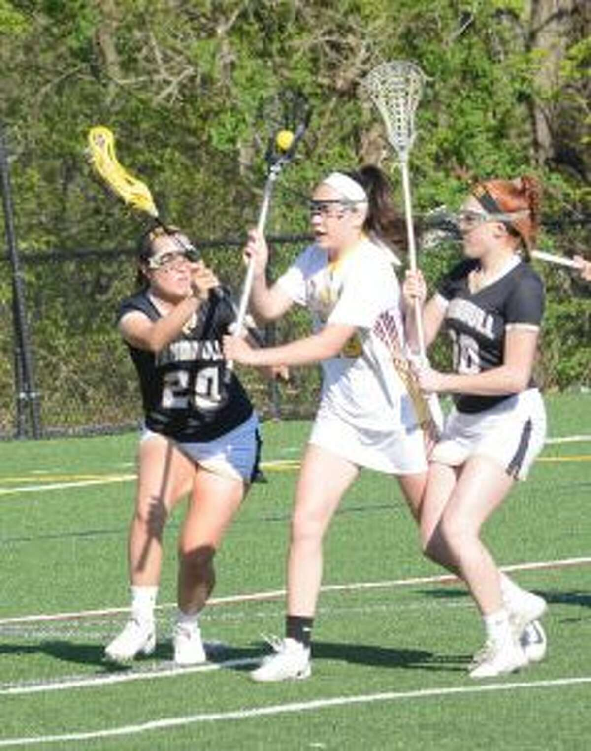 St. Joseph's Annie McNeil is flanked by Trumbull's Shaye Manton (20) and Callan Vaughn (10). - Andy Hutchison photos