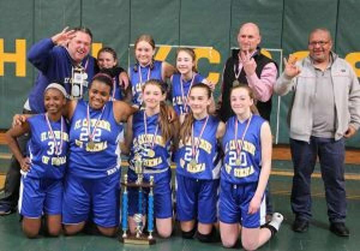 St. Catherine of Siena team members (front row) are: Maxannie Byron, Kirsten Rodriguez, Kate Rudini, Rosa Rizzitelli and Annie Stook; (second row) coach David Rudini, Bella Basso, Rosie Alibrandi, Maria Rizzitelli, coach Steve Basso and coach Miguel Rodriguez. Missing from photo is Hannah Silva.