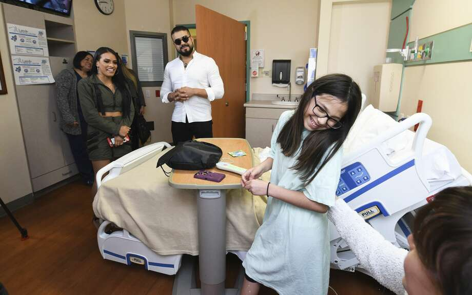 WWE wrestlers Zelina and Andrade surprise Larissa Garcia on Monday, Jun 3, 2019, as the performers visit children at the Laredo Medical Center's pediatrics ward. Photo: Danny Zaragoza/Laredo Morning Times