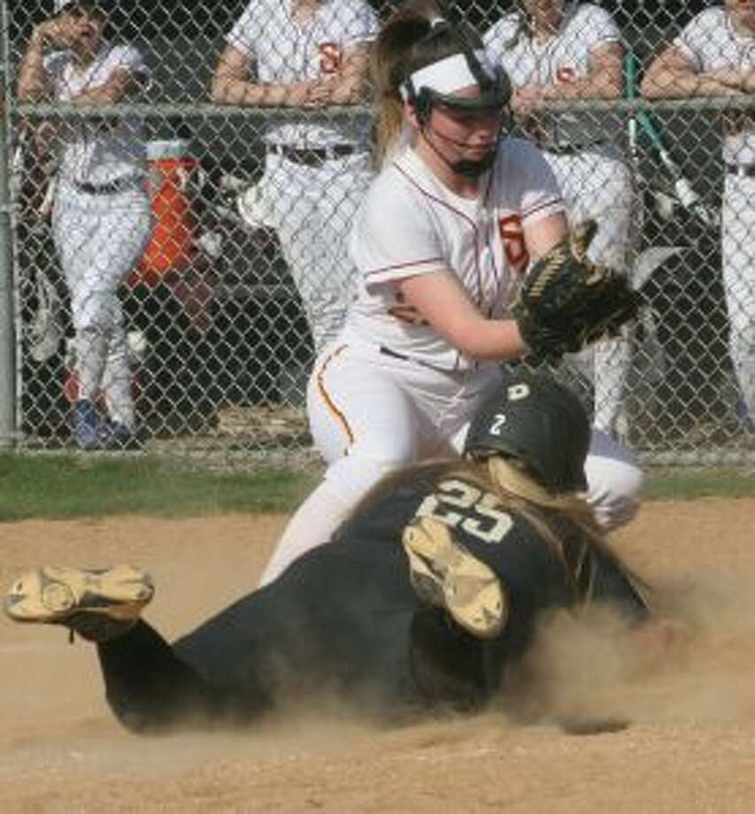 Trumbull High's Delihla Destefano slides into home before St. Joseph pitcher Cat Connell can make a tag. — Bill Bloxsom photos
