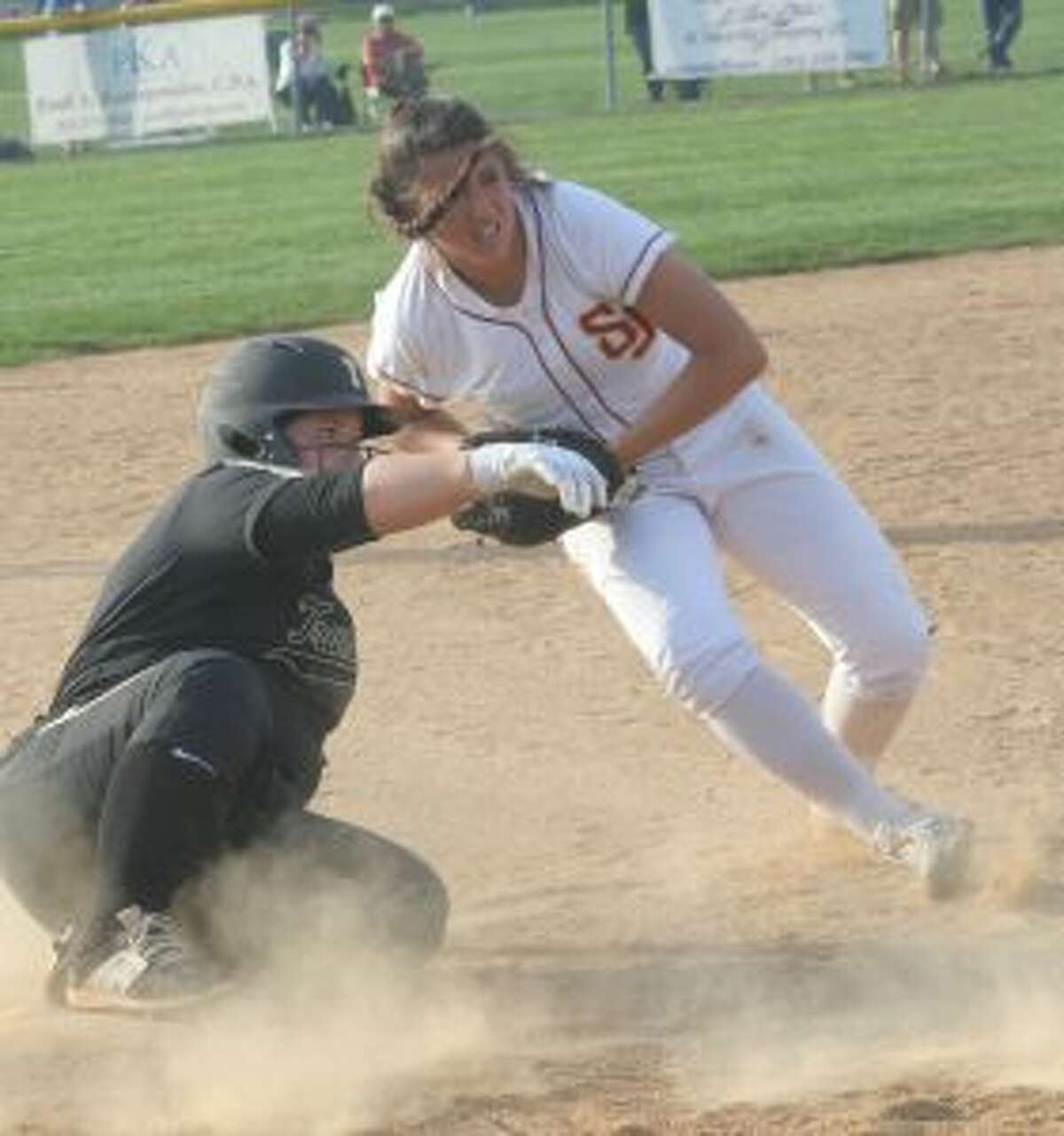 The Cadets' Kayla Giacobbe looks for confirmation after tagging out Mackenzie Bruggeman to complete a double play in the sixth inning.