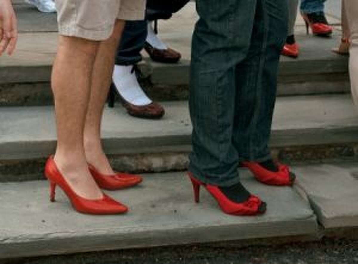 Many of the men who participated wore towering red heels.
