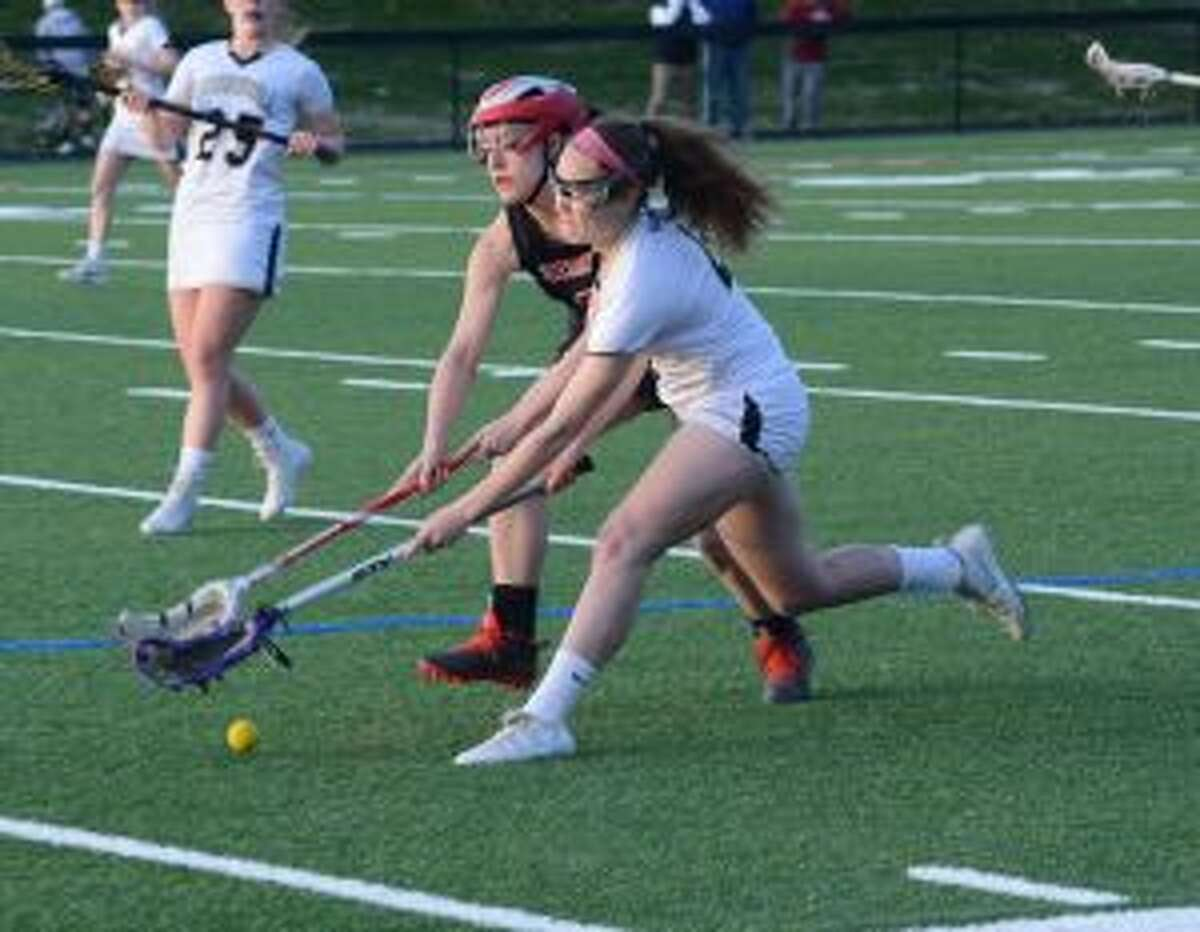 Emma Butler works for possession against Cheshire. - Andy Hutchison photo