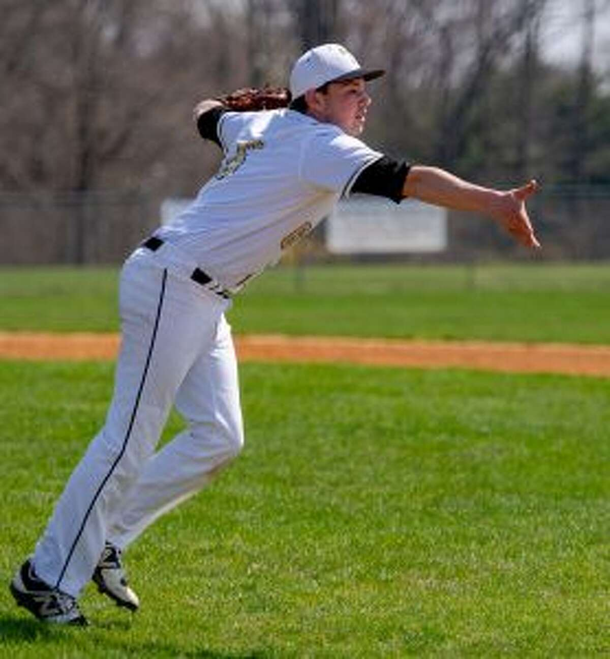 Evan Warner makes a toss to first base in the sixth inning. - David G. Whitham photo