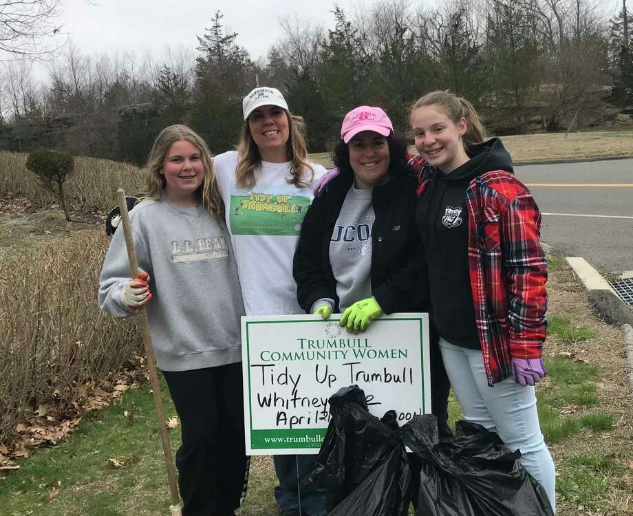Julie Howe can always be counted on to clean up Whitney Avenue here with her daughter and friends.