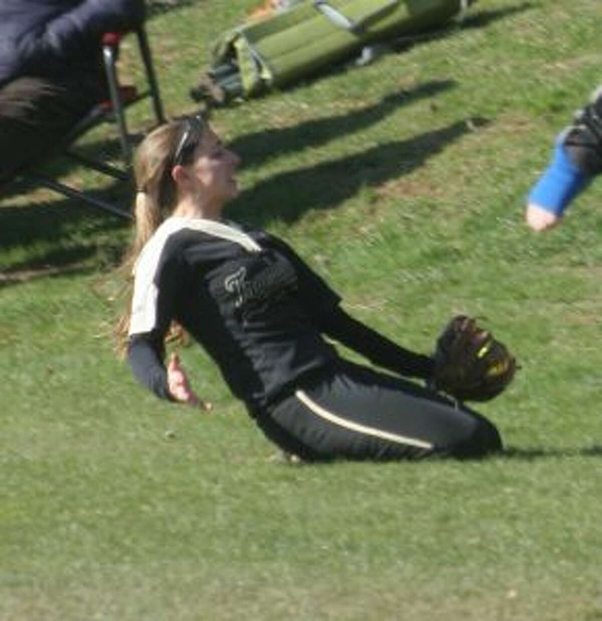 Maggie Coffin's first-inning catch of a foul ball was just outside the field of play.