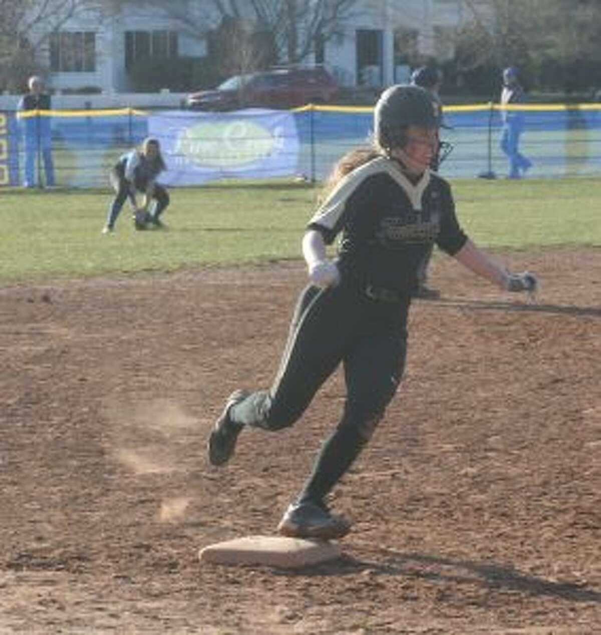 Courtney Fairfield rounds third base, as Ludlowe center fielder Madeline Reyes fields the ball.