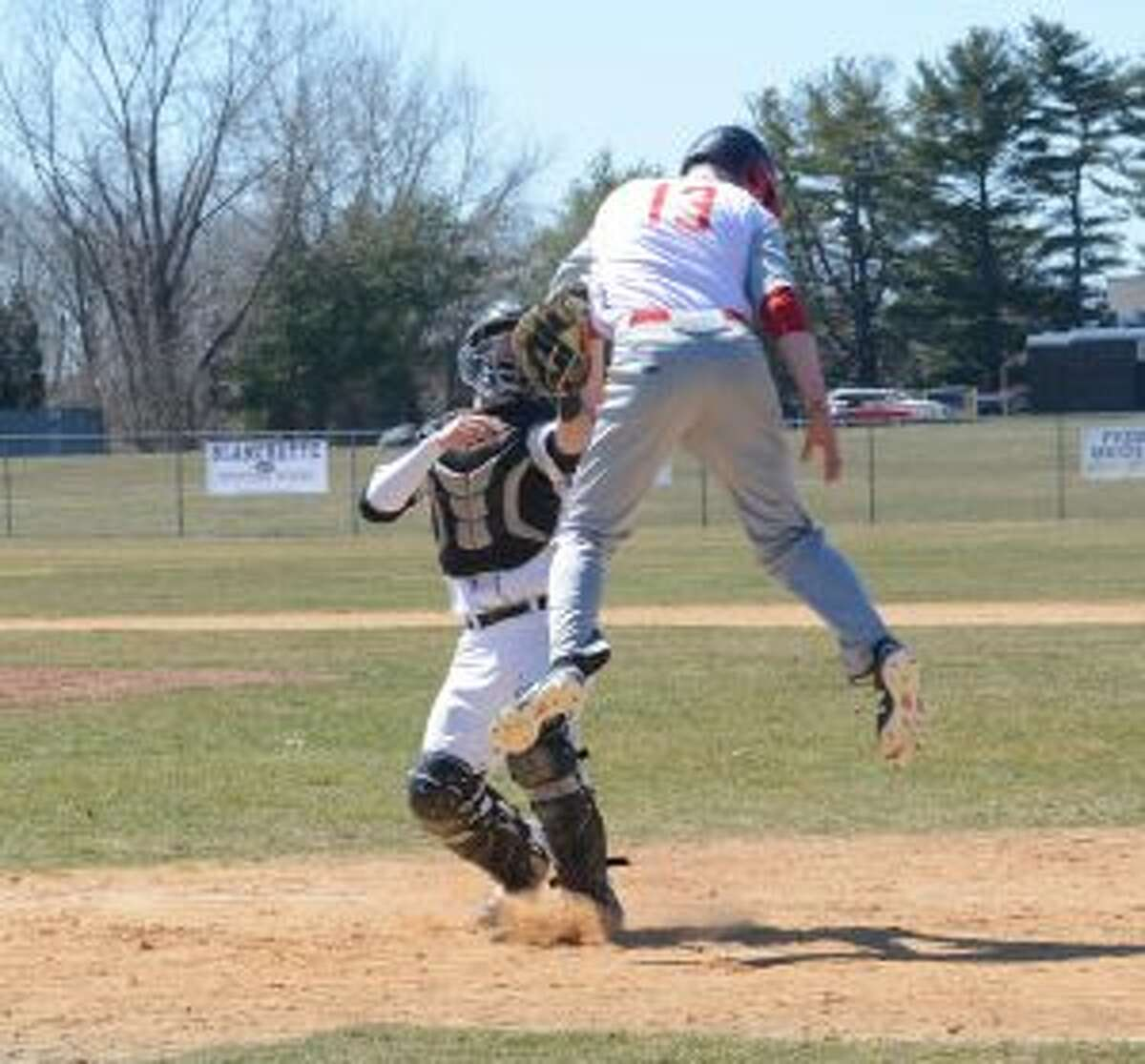 Kevin Bruggeman takes a throw from Justin Nyarady and tags out Masuk's John Wittenberger.