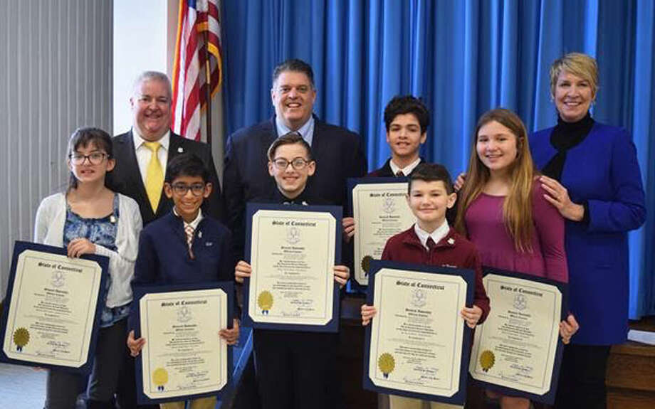 State Representatives David Rutigliano (R-123), Laura Devlin (R-134) and Ben McGorty (R-122) held a ceremony at the Trumbull Library to honor sixth grade winners of their third annual essay contest on March 10. Back row: State Reps. Ben McGorty (R-122), David Rutigliano(R-123) with essay contest winners and runner-up, front row: Annamarie Cretella, Dev Mehta, Jaden Buchetto, Bento Silva,  Joseph Saunders, Jane Parente and State Rep. Laura Devlin(R-134).