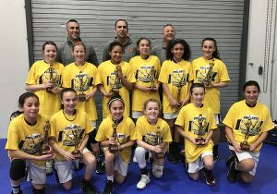 Team members (front row) are: Maddie Wilkins, Katelyn Landin, Caitlyn Elmo, Molly Vicente, Olivia DeLawder and Abby Gruttadauria; (second row) Remy DeNomme, Ryley Tate-Padian, Cheyenne Brand, Nola Antonio, Julia Johnson and Ava Mullen; (third row) head coach Matt Landin, assistant coach Brian Elmo and assistant coach Chris Gruttadauria.