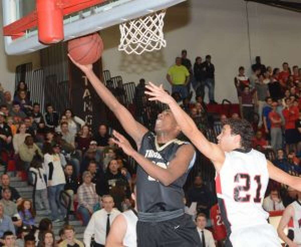 Timmond Williams puts the ball off the glass versus Warde. He scored 29 points to lead the Eagles. - Andy Hutchison photos