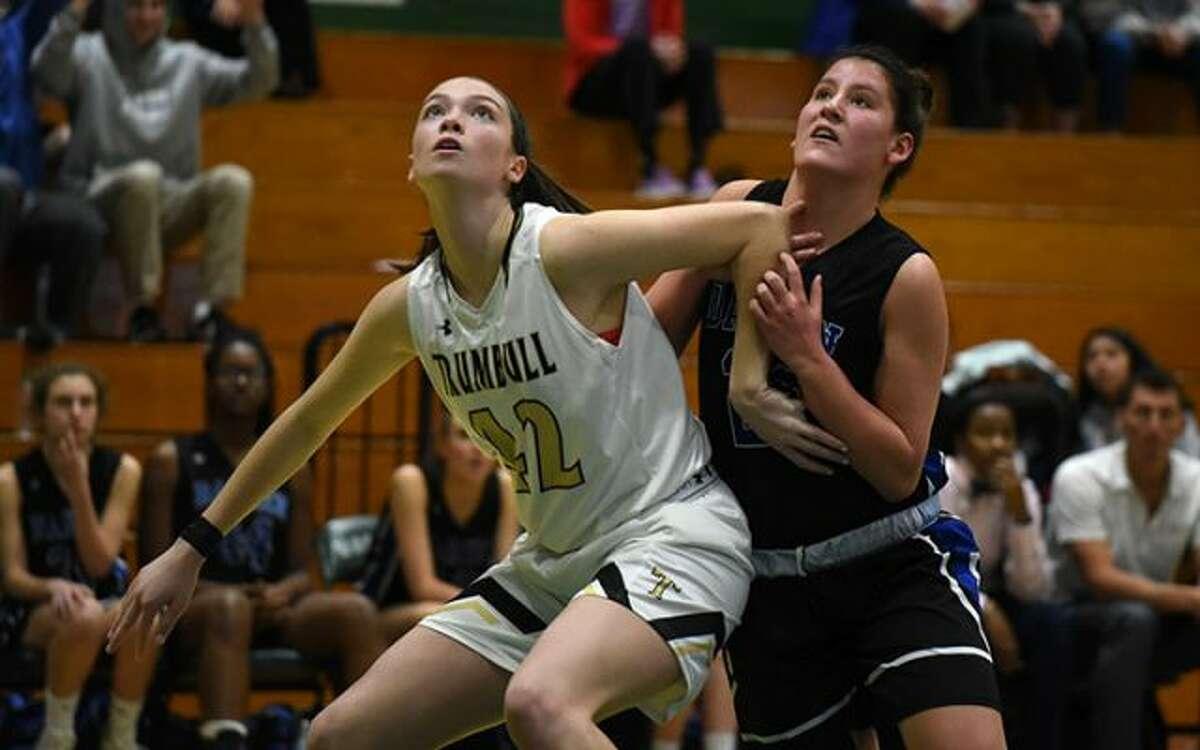 Trumbull's Brady Lynch battles Darien's Rachel Stobbie for a rebound during the FCIAC quarterfinals Saturday in Norwalk. - Dave Stewart photo