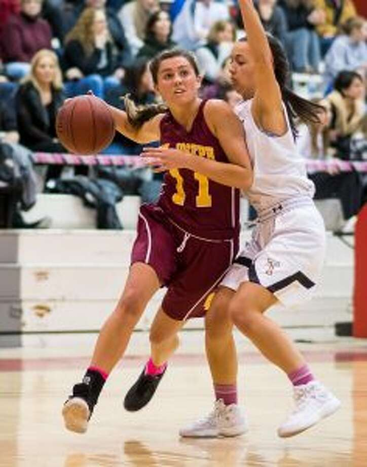 St. Joseph's Tessie Hynes takes the ball to the basket.