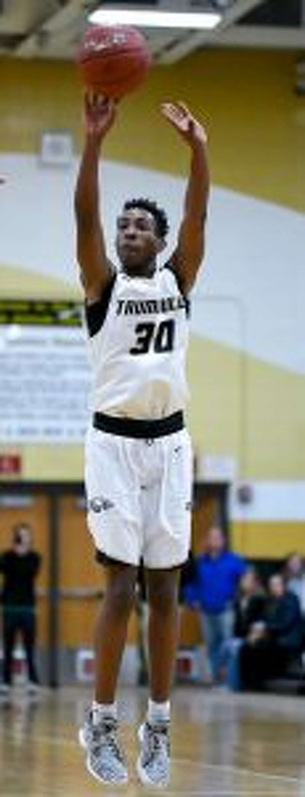 Timmond Williams matched his number with a 30-point performance. - David G. Whitham photos