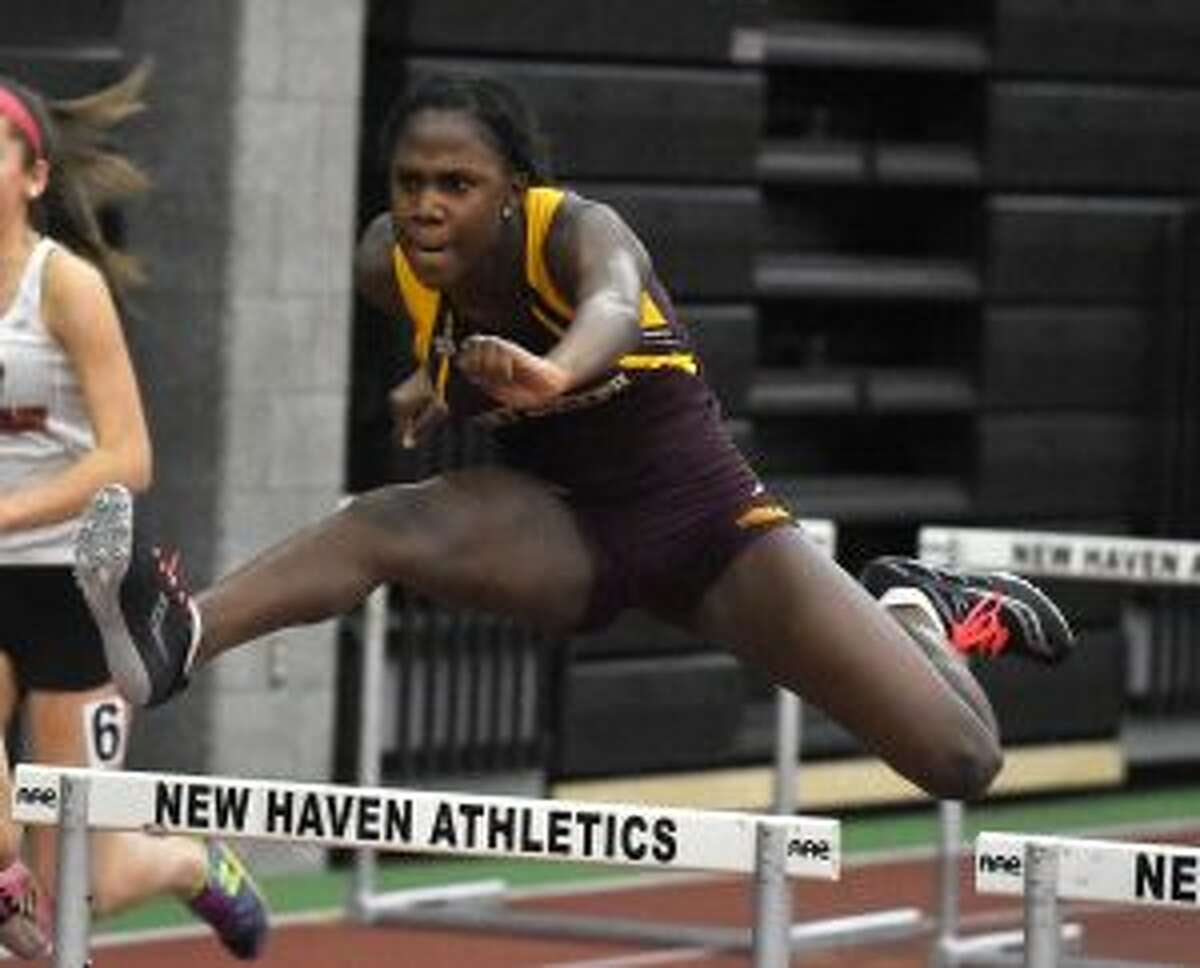 Nia Christie clears a hurdle on her way to a second-place finish. - Dave Stewart photo