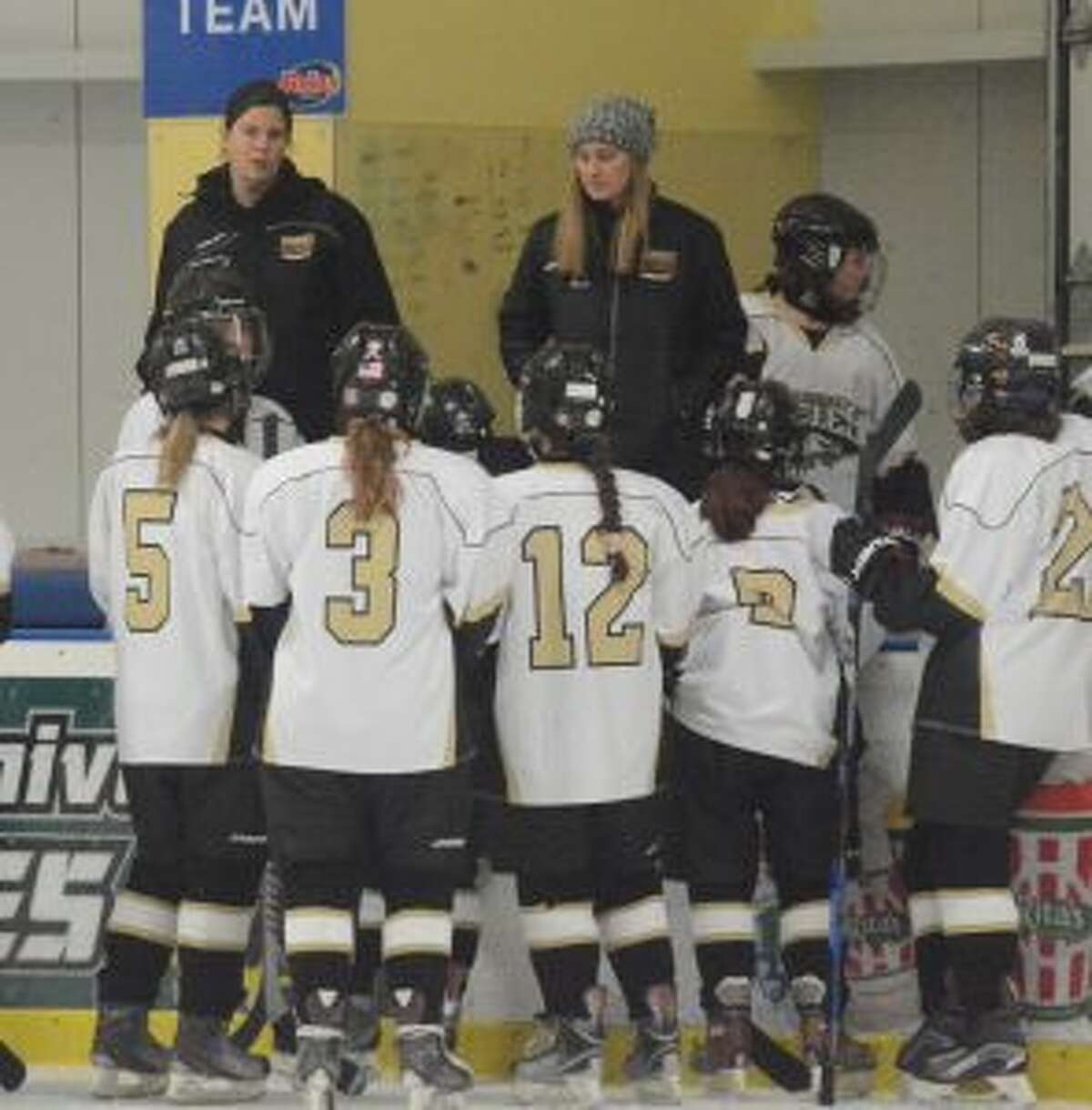 Trumbull-St. Joseph girls hockey head coach Paula Dady speaks to her players during the game with Masuk. - Andy Hutchison photo