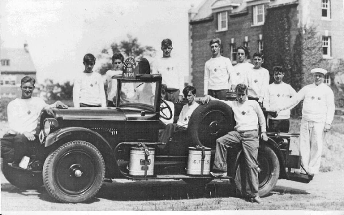 Nichols volunteers with the department's first vehicle, a Model T chemical truck, in 1917.