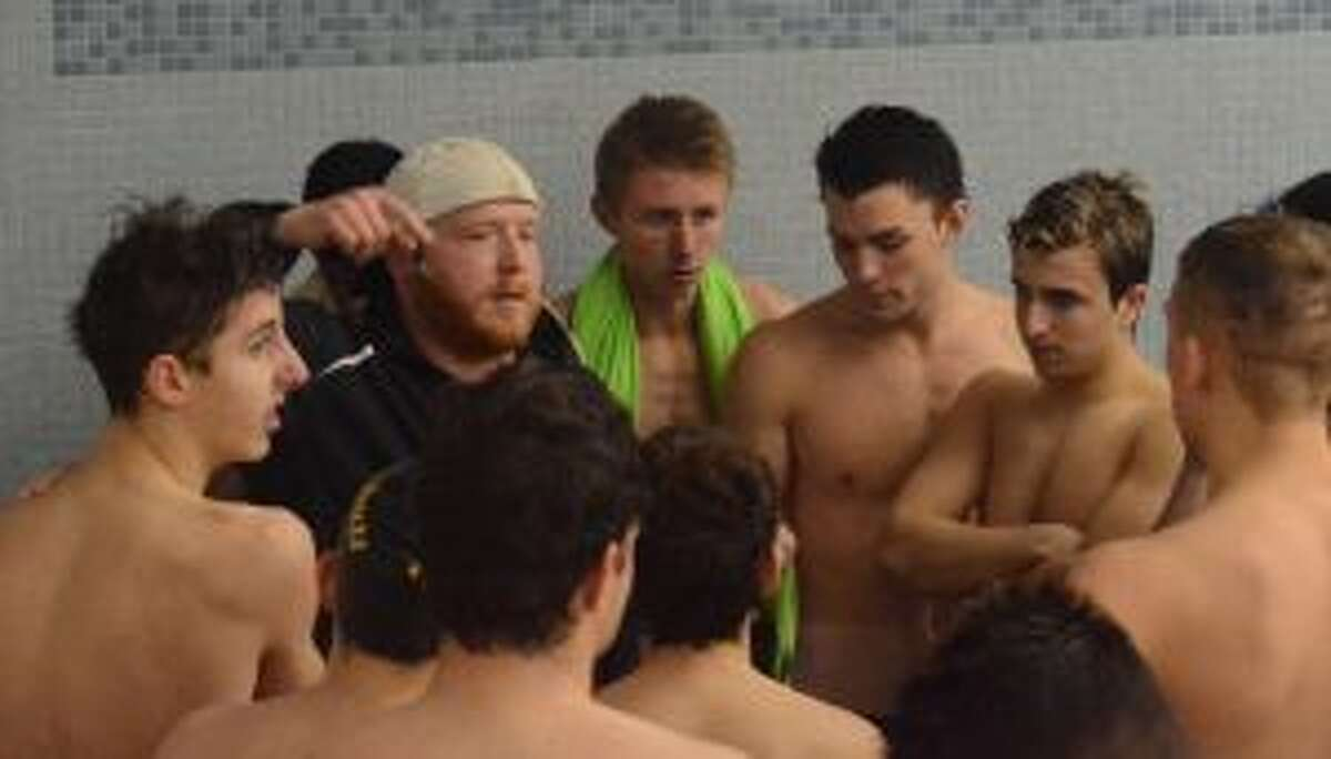Trumbull swim coach Bill Strickland instructs his team during the meet with Danbury. - Andy Hutchison photos