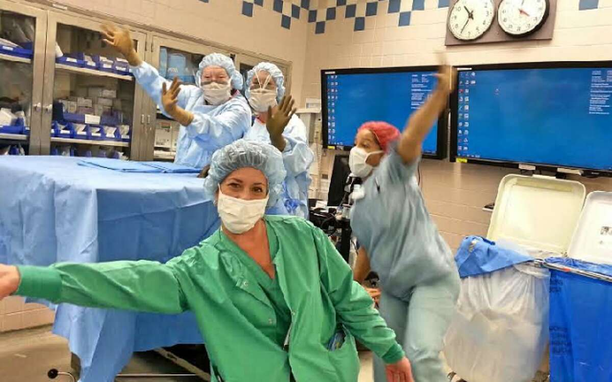 Karen Marlin and coworkers in a lighter moment at the Bridgeport Hospital operating room. - Isabel Perez photo
