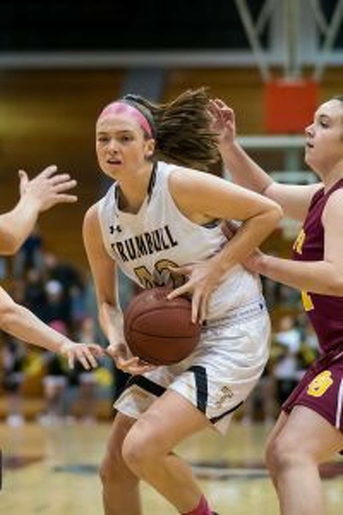 Trumbull High's Brady Lynch, Aisling Maguire and Julie Keckler have led the Eagles to 10-consecutive wins. - David G. Whitham photo