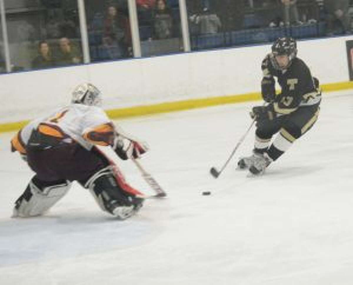 St. Joseph goalie Chris Higgins looks to make a save on Trumbull High's Alex Jackel. - Andy Hutchison photos