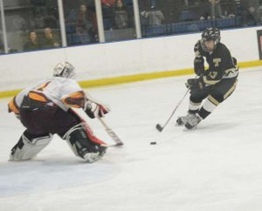 St. Joseph goalie Chris Higgins looks to make a save on Trumbull High's Alex Jackel. — Andy Hutchison photos
